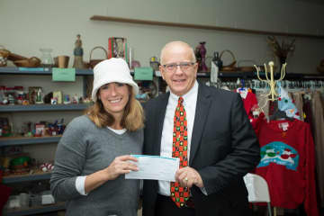 Executive Director of the Open Cupboard Food Pantry Jennifer Tavormina (left) accepts a donation from Relationship Manager for Unity Bank Tom Kasper (right). (Courtesy/)