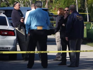 Investigators on scene in the 1100 block of Northeast 10th Street in Hallandale Beach, Fla., on Jan. 6, 2020. - Joe Cavaretta/South Florida Sun Sentinel/TNS