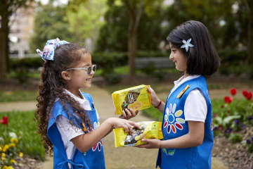 This year Girl Scouts debuts refreshed cookie packaging and a new lemon cookie available in select areas, Lemon-Ups, baked with inspirational messages. - Girl Scouts of the USA/Atlanta Journal-Constitution/TNS