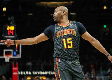 ATLANTA, GA - JANUARY 4: Vince Carter #15 of the Atlanta Hawks calls out to teammates during the fourth quarter of a game against the Indiana Pacers at State Farm Arena on January 4, 2020 in Atlanta, Georgia.