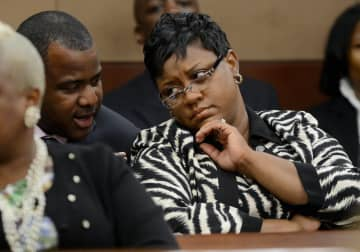Atlanta Public Schools Area superintendent Tamara Cotman, right, talks with her lawyer Benjamin Davis during a court hearing in Atlanta, Georgia, Thursday, May 2, 2013. - Kent D. Johnson/Atlanta Journal-Constitution/TNS