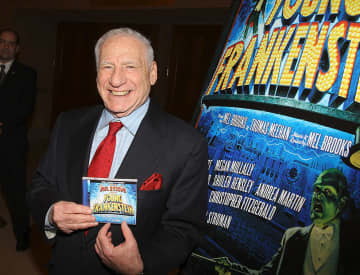 "Actor/director Mel Brooks signs copies of the cast recording of ""Young Frankenstein"" at The Hilton Theatre on February 27, 2008 in New York City, New York. - Stephen Lovekin/Getty Images North America/TNS"
