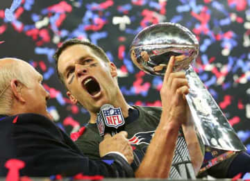 HOUSTON, TX - FEBRUARY 05: Tom Brady #12 of the New England Patriots holds the Vince Lombardi Trophy after defeating the Atlanta Falcons 34-28 in overtime during Super Bowl 51 at NRG Stadium on February 5, 2017 in Houston, Texas.