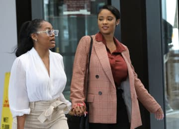 R. Kelly's girlfriends, left, Azriel Clary and Joycelyn Savage, leave following Kelly's hearing at the Leighton Criminal Court building, Sept. 17, 2019 in Chicago. - Antonio Perez/Chicago Tribune/TNS