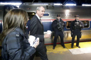 "Phil Murphy (right) and his wife, Tammy Murphy, board the ""chamber train"" in 2017. He was campaigning at the time but is now governor of New Jersey. (Aristide Economopoulos/)"