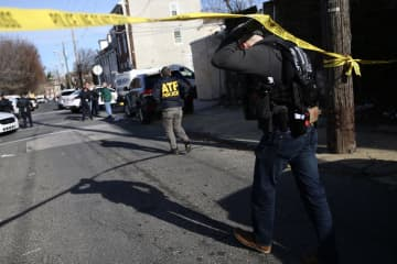 An ATF agent arrives on the scene of a reported shooting in the 4600 block of Hawthorne in Frankford, Pa., on Thursday, Jan. 9, 2020. - TIM TAI/The Philadelphia Inquirer/TIM TAI / Staff Photographer