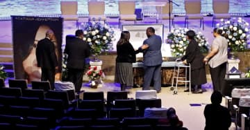 Mourners pay respects before the start of the funeral service for Atatiana Jefferson on October 24, 2019, at Concord Church in Dallas, Texas. - Stewart F. House/Getty Images North America/TNS