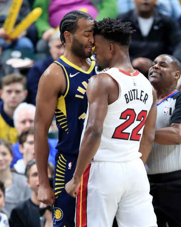 Jimmy Butler #22 of the Miami Heat and T.J. Warren #1 of  the Indiana Pacers get involved in an argument during the game at Bankers Life Fieldhouse on January 08, 2020 in Indianapolis, Indiana. - Andy Lyons/Getty Images North America/TNS