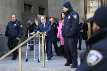 Harvey Weinstein leaves Manhattan Criminal Court with his attorneys amid a third day of jury selection on Thursday, Jan. 9, 2020, in New York. - Alec Tabak/New York Daily News/TNS