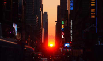 """A special sunrise known as the """"Reverse Manhattanhenge"""" is coming to New York City this weekend. Pictured is a summer sunset in Manhattan. (Pixabay/)"""