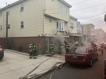 Firefighters tackle a basement fire on New Street Friday morning. (Courtesy of Bayonne Fire Department/)