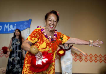 Kau'i Brandt, or Auntie Kau'i to those that knew her, performs during the Ho'AOolaulei (meaning Open House) show at Disney's Polynesian Village Resort on September 20, 2014. - Jacob Langston/Orlando Sentinel/TNS