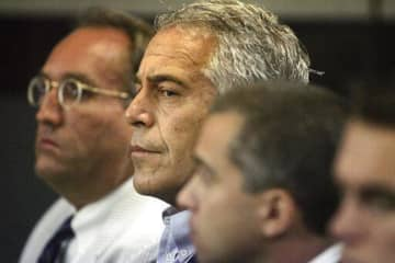 Jeffrey Epstein, center, at a West Palm Beach, Fla., court appearance in July 2008. - Palm Beach Post/Palm Beach Post/TNS