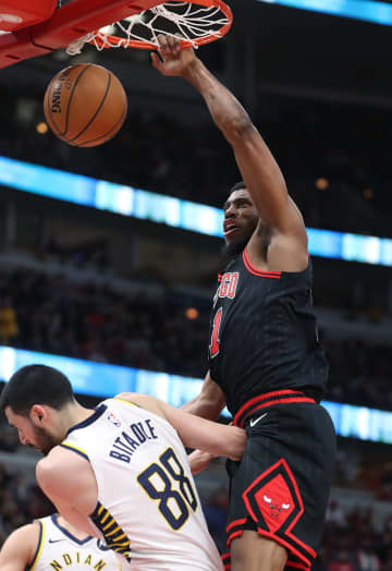 The Chicago Bulls' Thaddeus Young (21) dunks over the Indiana Pacers' Goga Bitadze (88) in the second quarter at the United Center in Chicago on Friday, Jan. 10, 2020. - John J. Kim/Chicago Tribune/TNS