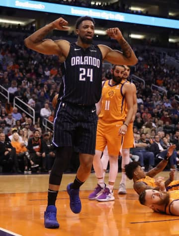 The Orlando Magic's Khem Birch (24) reacts after scoring against the Phoenix Suns during the first half at Talking Stick Resort Arena in Phoenix on Friday, Jan. 10, 2020. The Suns won, 98-94. - Christian Petersen/Getty Images North America/TNS