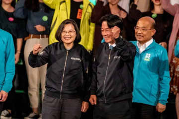 Taiwan's President Tsai ing-wen and her running mate, former premier William Lai appear at a rally held by the Democratic Progressive Party on election day, January 11. Photo: Viola Kam/United Social Press.