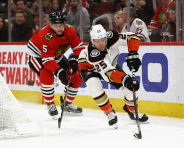 The Anaheim Ducks' Ondrej Kase (25) prepares a shot on  goal in front of the Chicago Blackhawks' Connor Murphy (5) at the United Center in Chicago on Satruday, Jan. 11, 2020. The Blackhawks won, 4-2. - Jonathan Daniel/Getty Images North America/TNS