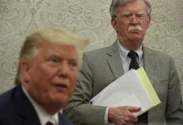 President Donald Trump with his former National Security Adviser John Bolton. Bolton objected to the pressure campaign on Ukraine, and now says he's willing to testify in the Senate. (Photo by Alex Wong/Getty Images) (Alex Wong/)