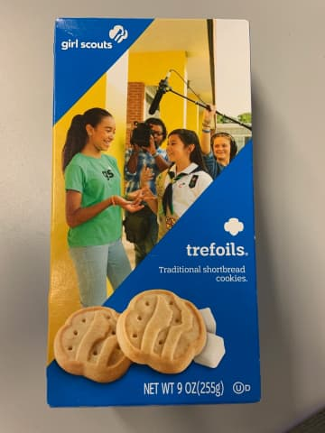 The new packaging for the classic Trefoils shortbread Girl Scout cookie, like other new packaging, features girls doing an activity available via Scouting. - David J. Neal/Miami Herald/TNS