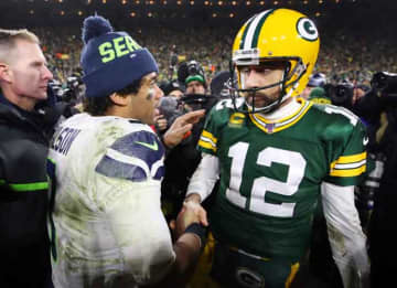 GREEN BAY, WISCONSIN - JANUARY 12: Russell Wilson #3 of the Seattle Seahawks greets Aaron Rodgers #12 of the Green Bay Packers after the Packers defeated the Seahawks 28-23 in the NFC Divisional Playoff game at Lambeau Field on January 12, 2020...