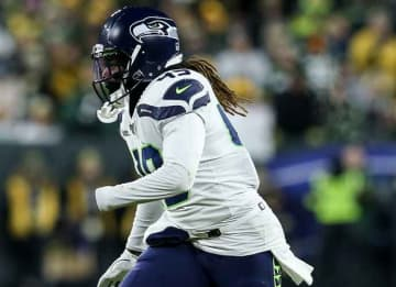 GREEN BAY, WISCONSIN - JANUARY 12: Shaquem Griffin #49 of the Seattle Seahawks in action in the fourth quarter against the Green Bay Packers during the NFC Divisional Round Playoff game at Lambeau Field