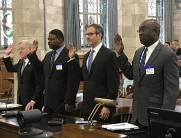 New NJ Transit board members, left to right, Robert Gordon, Cedric Fulton, Richard Maroko and James D. Adams, testify before the state Senate Judiciary Committee Monday. (Larry Higgs/)