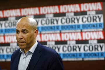 U.S. Sen. Cory Booker, D-N.J., speaks with attendees after a Jan. 9, 2020, campaign event in Mount Vernon, Iowa.  (Patrick Semansky/)