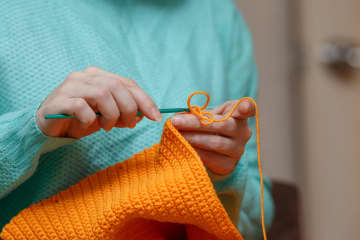 Debra-Lynn B. Hook had never knit or crocheted before, intimidated because she saw them as perfectionists' crafts. - Ivan Karpov/Dreamstime/TNS