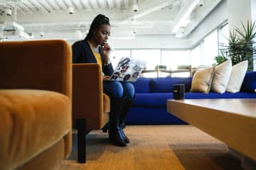 Shaniqua Davis, who runs a new business Noirefy, which helps companies look for job candidates from diverse backgrounds, gets some work done on her laptop Jan. 6, 2020, at a WeWork co-working space in Chicago. - Jose M. Osorio/Chicago Tribune/TNS
