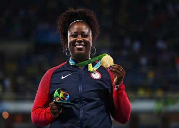 Gold medalist Michelle Carter of the United States celebrates on the podium during the medal ceremony for the Women's Shot Put on Day 8 of the Rio 2016 Olympic Games at the Olympic Stadium on August 13, 2016 in Rio de Janeiro, Brazil.