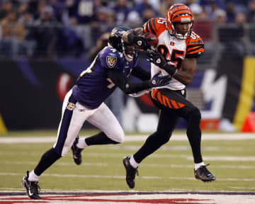 Cincinnati Bengals wide receiver Chad Johnson (85) makes a reception before Baltimore Ravens cornerback Willie Gaston during first half action at M&T; Bank Stadium in Baltimore, Maryland, Sunday November 11, 2007. - Rafael Suanes/TNS/TNS