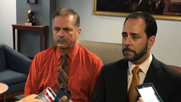 Frank Nucera (left), the former Bordentown police chief, and his defense attorney Rocco Cipparone address the media Oct. 11, 2019 after a mistrial was announced on two charges. Nucera was convicted of lying to the FBI. (Joe Brandt/)