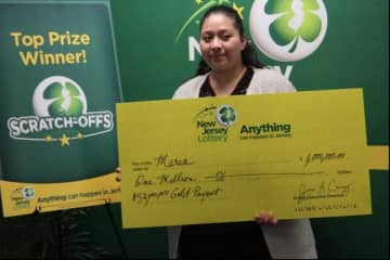 Maria Lopez won $1 million with a $52,000,000 Gold Payout scratch-off ticket she bought for $10. (New Jersey Lottery/)