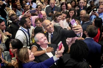Gov. Phil Murphy (left) and U.S. Sen. Cory Booker (right) take a selfie with audience members in Atlantic City last year. (Aristide Economopoulos | NJ Adva                    /)