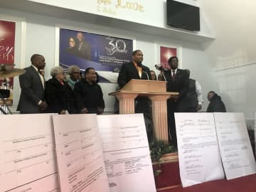 Atlantic City Mayor Marty Small Sr. (center) speaks during a press conference inside the Grace Family Church in Atlantic City (Chris Franklin/)