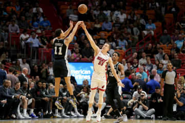 The San Antonio Spurs' Bryn Forbes (11) shoots over the Miami Heat's Duncan Robinson (55) in the first quarter at the AmericanAirlines Arena in Miami on Wednesday, Jan. 15, 2020. The Heat won, 106-100. - CHARLES TRAINOR JR/Miami Herald/TNS