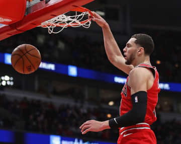 The Chicago Bulls' Zach LaVine dunks against the Washington Wizards at the United Center in Chicago on Wednesday, Jan. 15, 2020. The Bulls won, 115-106. - Jonathan Daniel/Getty Images North America/TNS
