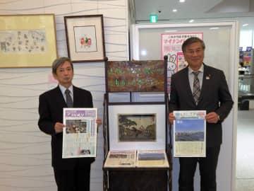 新しいラックを披露する桒山さん(左)と鈴木市長