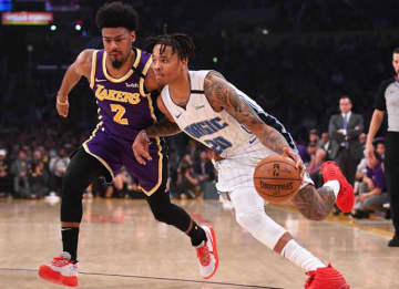 LOS ANGELES, CA - JANUARY 15: Quinn Cook #2 of the Los Angeles Lakers guards Markelle Fultz #20 of the Orlando Magic as he drives to the basket in the first half of the game at Staples Center on January 15, 2020 in Los Angeles, California.