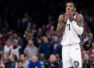PHILADELPHIA, PA - JANUARY 15: Kyrie Irving #11 of the Brooklyn Nets wipes his face against the Philadelphia 76ers in the fourth quarter at the Wells Fargo Center on January 15, 2020 in Philadelphia, Pennsylvania.