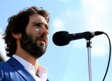 LOUISVILLE, KY - MAY 02: Josh Groban sings the National Anthem at the 141st Kentucky Derby at Churchill Downs on May 2, 2015 in Louisville, Kentucky. (Photo by Tasos Katopodis/Getty Images for Churchill Downs)