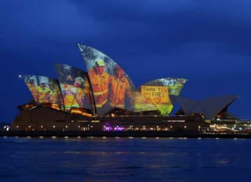 SYDNEY, AUSTRALIA - JANUARY 11: Images taken during the ongoing bushfire crisis are projected on the sails of the Sydney Opera House on January 11, 2020 in Sydney, Australia. The projections are to show support for communities affected by...