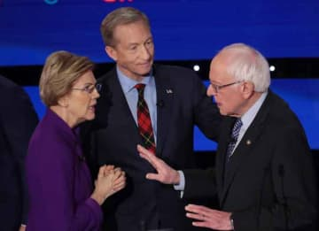 DES MOINES, IOWA - JANUARY 14: Sen. Elizabeth Warren (D-MA) and Sen. Bernie Sanders (I-VT) speak as Tom Steyer looks on after the Democratic presidential primary debate at Drake University on January 14, 2020 in Des Moines, Iowa.