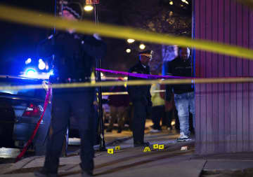 Chicago Police process a crime scene after five people reportedly were shot at Pulaski Road and Maypole Avenue in Chicago on Thursday, Jan. 16, 2020. - Terrence Antonio James/Chicago Tribune/TNS