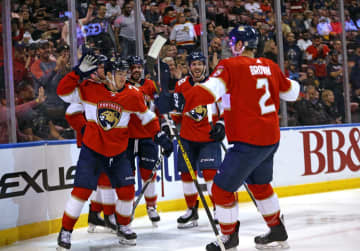 The Florida Panthers' Frank Vatrano (77) is congratulated by teammates after scoring during the second period against the Los Angeles Kings at the BB&T; Center in Sunrise, Fla., on Thursday, Jan. 16, 2020. - DAVID SANTIAGO/Miami Herald/TNS