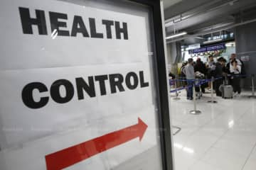 Suvarnabhumi airport is adopting stricter health measures to monitor travellers arriving from China, where a mysterious viral pneumonia has broken out.