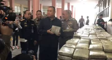 Police display more than a tonne of seized compressed marijuana at a media briefing in Bangkok on Friday. (Supplied photo)