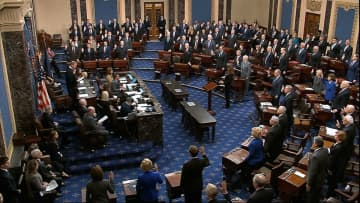 In this image from video, Chief Justice John Roberts swears in members of the Senate for the impeachment trial against President Donald Trump at the U.S. Capitol on Jan. 16, 2020. (Senate Television via AP/)