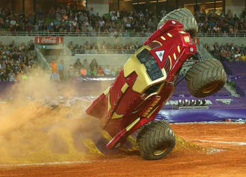 MELBOURNE, AUSTRALIA - OCTOBER 04: Lee O'Donnell driving Iron Man crashes during Monster Jam at AAMI Park on October 4, 2014 in Melbourne, Australia.