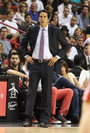 In a 2014 file image, Miami Heat head coach Eric Spoelstra watches action against the Milwaukee Bucks at the AmericanAirlines Arenia in Miami. The Heat lost to the New York Knicks 124-121 on Sunday, Jan. 12, 2020. - Hector Gabino/El Nuevo Herald/TNS
